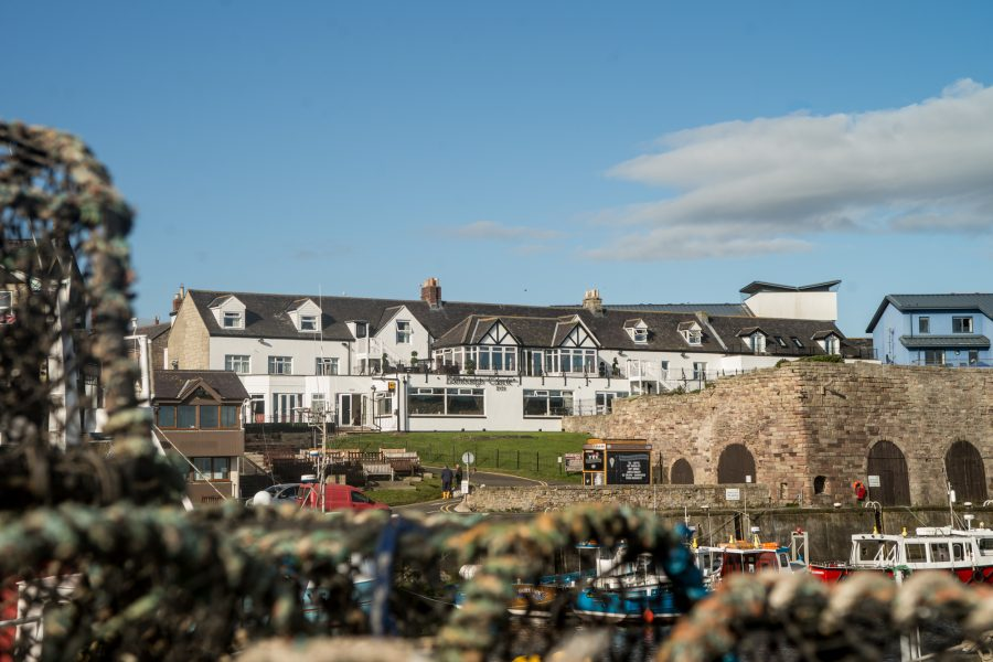 5-bamburgh-castle-view-overlooking-harbour-in-seahouses-1