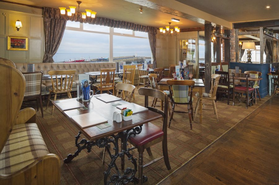 bam2-bamburgh-castle-inn-dining-area-overlooking-seahouses-harbour
